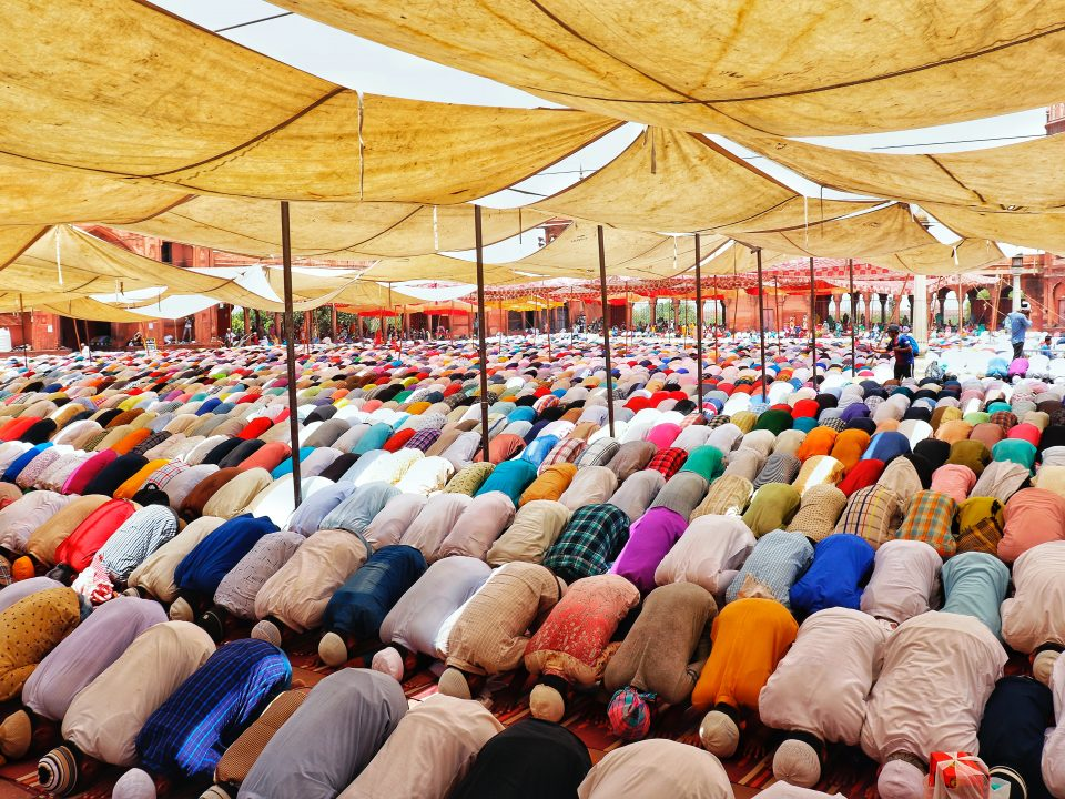 people bowing down inside canopy during day